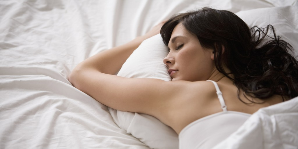 woman-sleeping-relaxing-bed