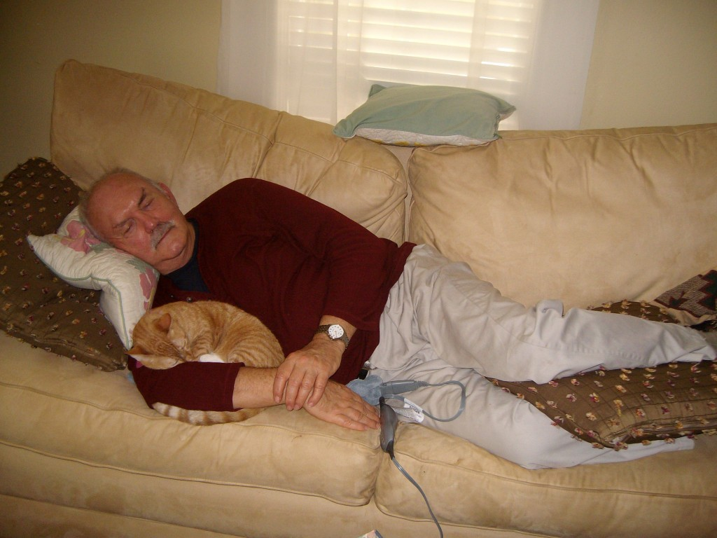 man-sleeping-with-cat