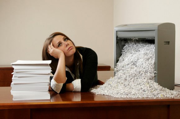 identity-theft-victim-shredding-documents-medium-579x385