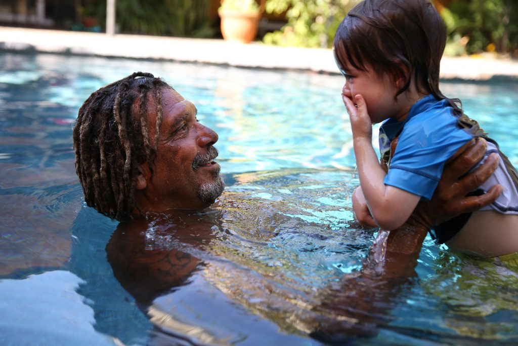 man-in-pool-daughter